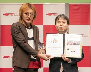 写真:第6回「GOOD ACTION アワード」で審査員賞を受賞した株式会社KMユナイテッド